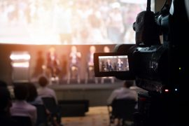 Video Presentation media and live streaming record and broadcast in real time for social network concept. VDO camera taking live video streaming at seminar technology event with flare light effect.